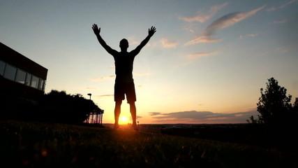 Young muscular man in tank top doing english push ups at park