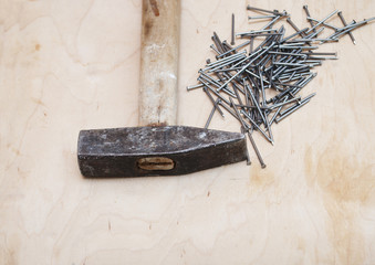 hammer and a pile of nails