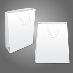 Two realistic white blank paper bags. Isolated on grey