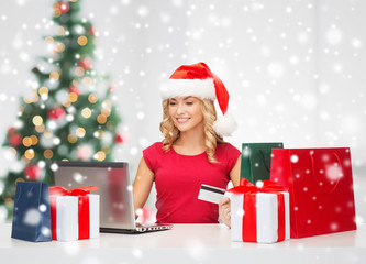 woman with gift boxes and laptop computer