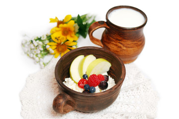 Milk and curd with summer fruits in ceramic bowls