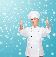 smiling female chef showing thumps up