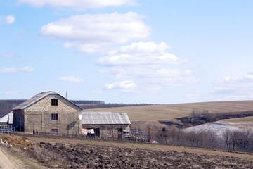 Landscape-country house amid mountainous terrain