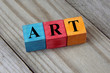 concept of art word on colorful wooden cubes