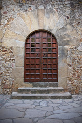Doorway in Pals, a famous medieval Town in Costa Brava, Spain