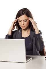 young beautiful businesswoman has bad headache