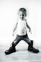 Little boy in military boots