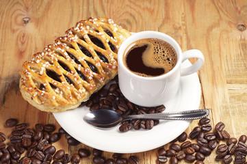 Coffee and bun with jam