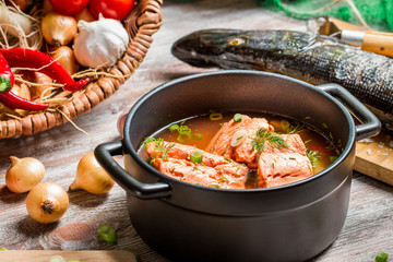 Spicy fish soup made ​​of salmon and spiced with dill