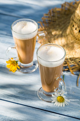 Coffee latte served in a sunny day