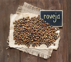 Raw organic roveja beans with a small chalkboard