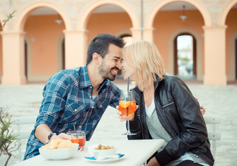 Couple drinking aperitif in a Bar