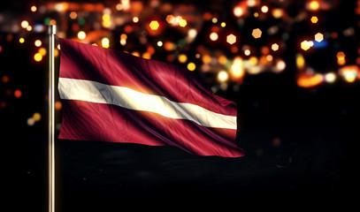 Latvia National Flag City Light Night Bokeh Background 3D