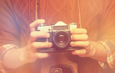 Man holding retro photo camera