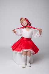 Sweet little ballerina posing in folk costume
