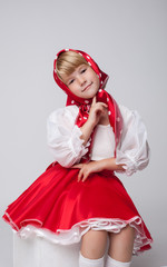 Image of smiling blonde girl in folk costume