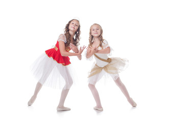 Two adorable ballet dancers, isolated on white