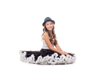 Studio shot of funny young ballerina in hat