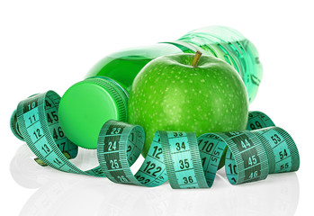 Fitness, weight loss concept with towel, green apple