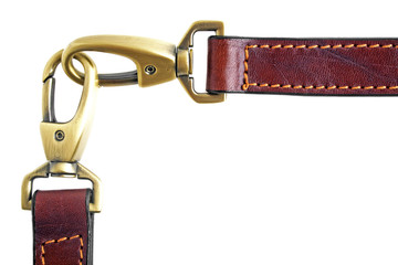 A double carabiner lock on a leather belt, isolated