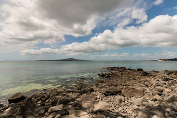 long white clouds above Rangitoto Island