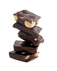 Dark chocolate with nuts on a white background, closeup
