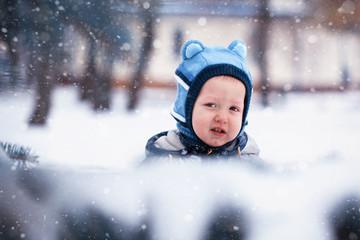closeup portrait Little winter baby boy, snowing