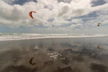 kitesurfers on Muriwai beach