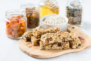 Healthy homemade granola bars and   ingredients  on  background