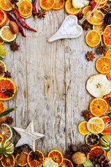 Dried fruits and christmas spices on wooden background