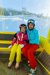 Skiing, skiers in cable car