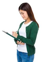 Asian woman write on clipboard