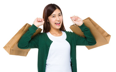 Excited woman with shopping bag