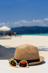 hat and sunglasses on beach vacation