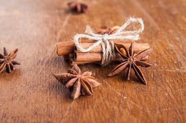 Cinnamon sticks and star anise on rustic wood