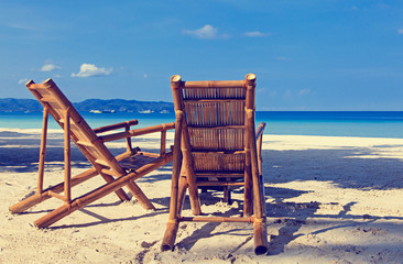 Two chairs on sand beach in Boracay, Philippines
