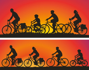 cyclists silhouettes on the background of sunsets