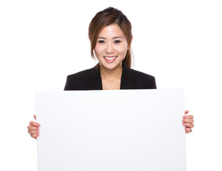 Businesswoman with white banner