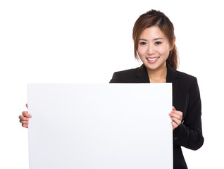 Businesswoman with white poster