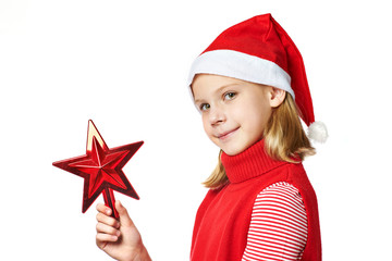 Beautyful girl in Santa hat with red toy star