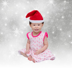 Happy asian girl with christmas hat over snow background