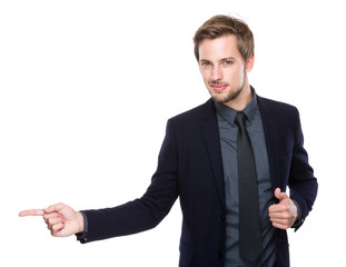 Businessman with finger point aside