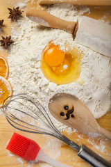 Baking preparation: eggs, flour, rolling pin, the mixer board
