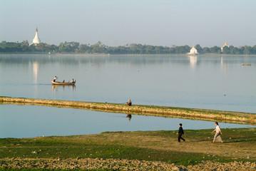 People walking near river Ayeyarwad, Myanmar