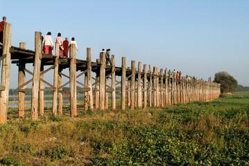 People walking on the wooden bridge of U Bein on river Ayeyarwad