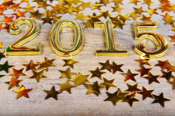 New year composition of golden numbers 2015 year and gold asteri