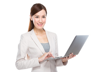 Businesswoman use of notebook