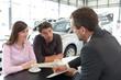 Leinwanddruck Bild - Verkaufsgespräch im Autohandel // Sales talk in the car trade