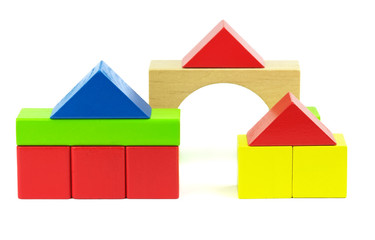 Houses made from toy wooden colorful building blocks