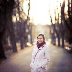 Seasonal portrait of a young woman outdoors in a park